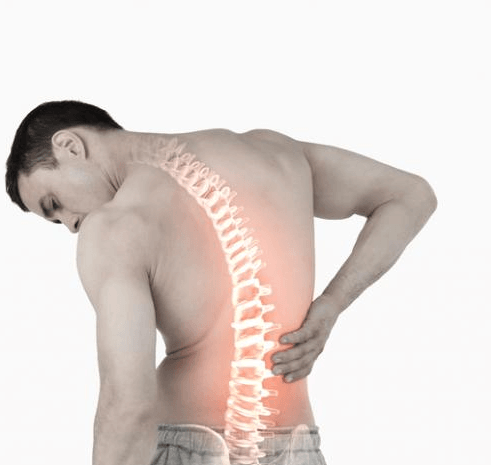a man with visible spine holds his back