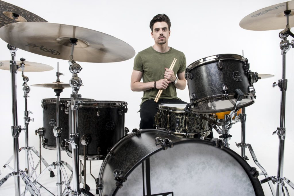 This image has an empty alt attribute; its file name is a-drummer-with-his-accessories-and-drum-kit-1024x684.jpg